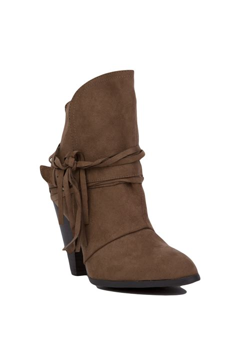 Buckled Heel Ankle Boots lyst buckled fringe heeled ankle booties taupe
