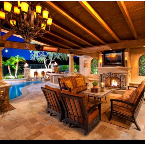 outdoor entertainment area with fireplace and wooden beams