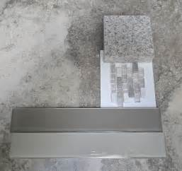 smokey grey taupe tile and quartz counter tops my new