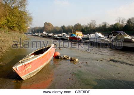 thames river cruise london richmond a small boat sits in very low tide along the river thames