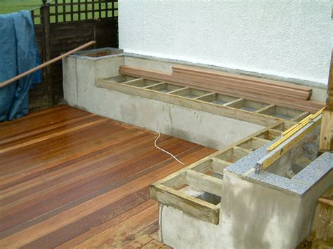 build a bench seat for garden we then added the hardwood decking leaving cables showing