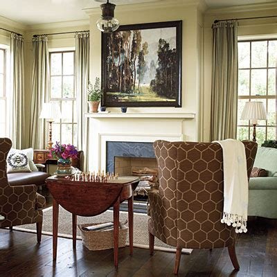 the keeping room furniture mantel decorated with greenery in southern living idea house