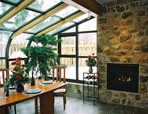 sunroom with fireplace home of dreams