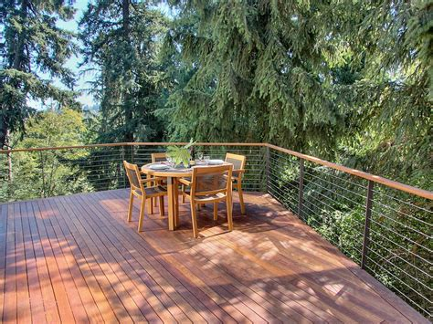 glass banisters cost glass railing cost deck rustic with beige patio umbrella cantilevered