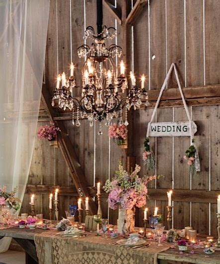 Rustic country wedding table. obsessed with the chandelier