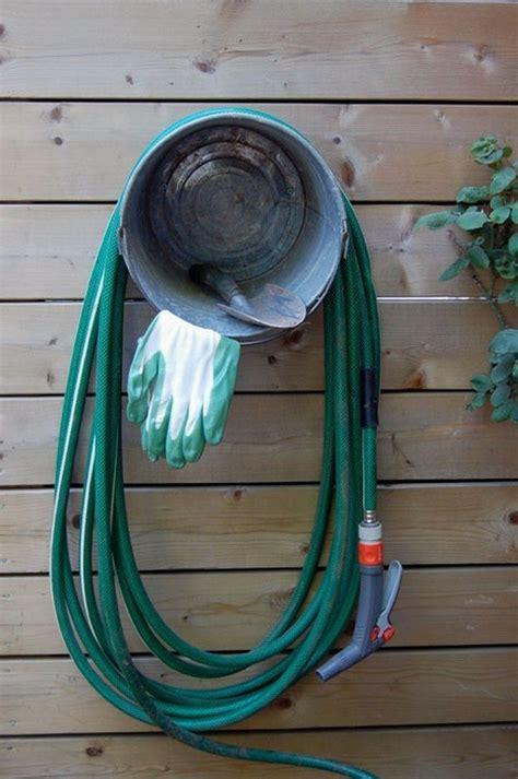Garden Hose Storage Ideas Build A Garden Hose Storage With Planter Diy Projects For Everyone