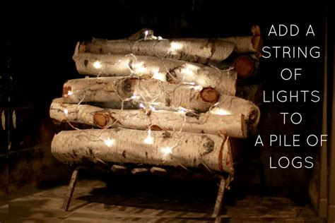 fake fireplace logs with lights easy fireplace filler idea with a seasonal upgrade