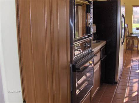 transforming kitchen cabinets diy painter uses new rustoleum cabinet transformations on