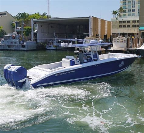 xpress boats instagram midnight express 39s cuddy in blue with triples boat
