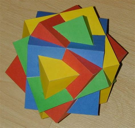 Geometric Shapes With Paper - paper model compound of four cubes website has tons of