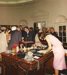 Jacqueline kennedy writing on the president s oval office desk n the