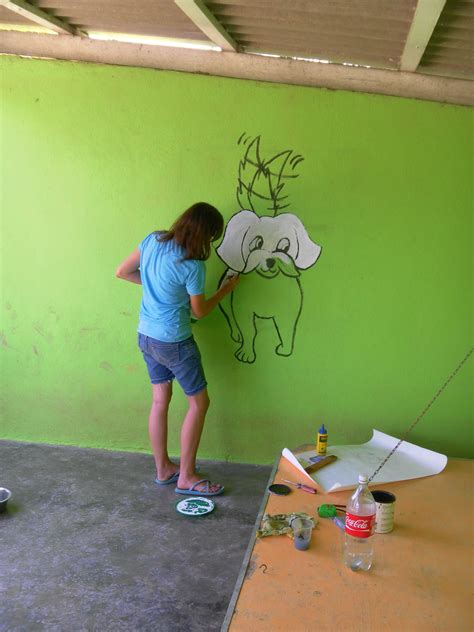 Wall Mural Artist artist yonne latiers painted murals in the puppy kennel