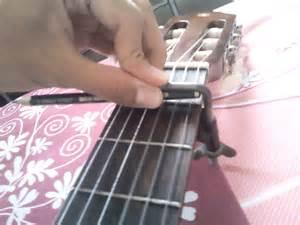 Penyangga Senar Gitar cara buat capo dari pensil dan penyangga rautan pensil