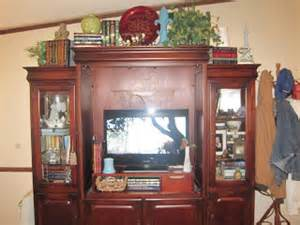 Decorating Ideas Above Entertainment Center On Willie Mae Thrifty Living Room Decor