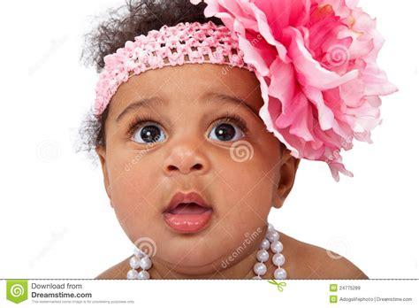 closeup of beautiful baby with flower headband stock photo baby with flower headband closeup royalty free stock