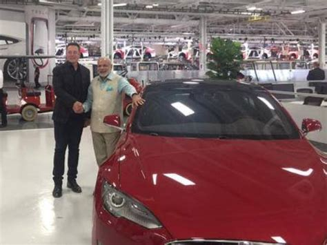 Tesla Motors India Price Narendra Modi Gets A Guided Tour Of Tesla Motors By Ceo