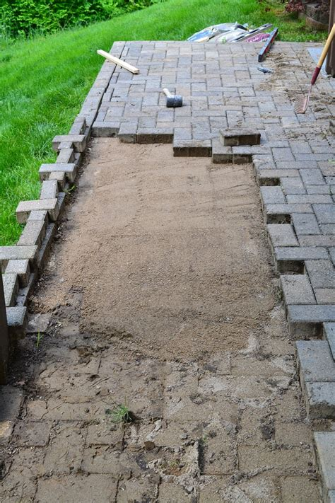 pictures of patios with pavers repairing sunken patio pavers
