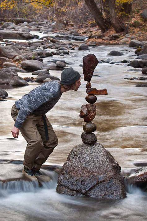 by michael grab rock balancing artist creates serene art by balancing rocks lost in