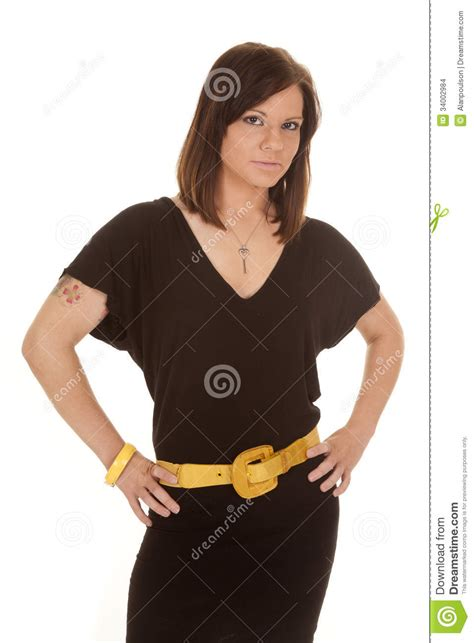 black dress yellow belt hips stock images