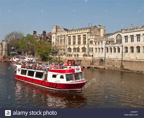 boat cruise york uk river cruise boat on river ouse passing the guildhall york
