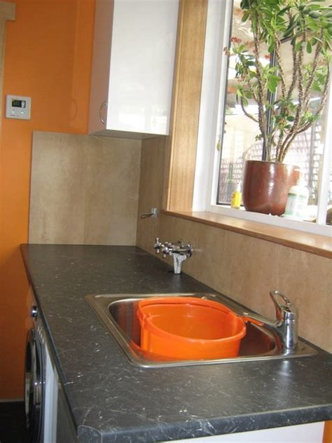 orange laundry orange laundry modern laundry room other