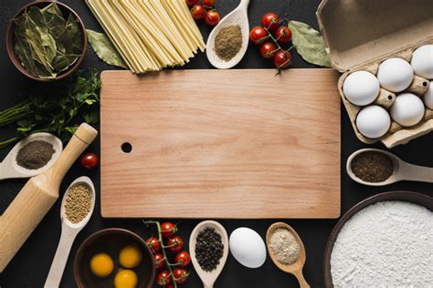 cooking board board amidst cooking ingredients photo free download
