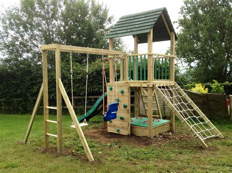 swing climbing frame treetops tower wooden climbing frame with monkey bars and