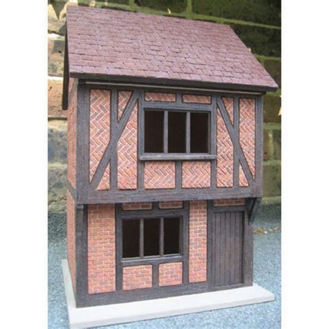 small tudor dolls house  scale externally decorated