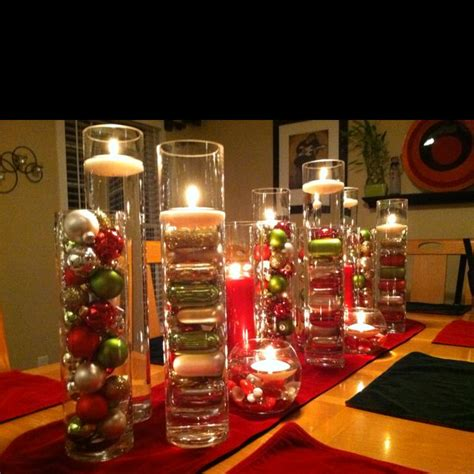 a number of cylinder vases filed with bulbs or water and