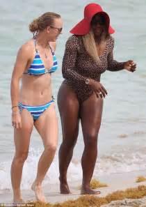 Caroline wozniacki and serena williams hook up to hit the beach in