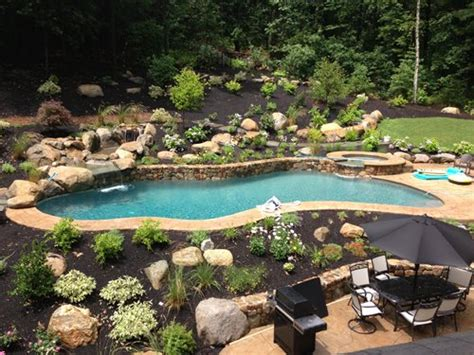 sloped backyard pool hillside becomes statement making pool landscaping network