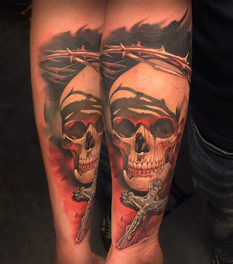 cross and skull tattoo 3d skull with cross on left forearm