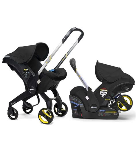 and black infant car seat and stroller doona infant car seat black