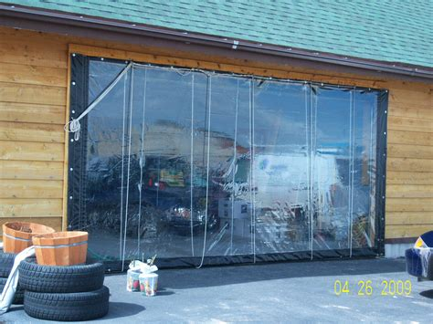 garage door curtain solar heated shop garage using vinyl curtain