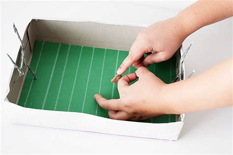 How To Make A Paper Football Stadium - paper football let s go chipper