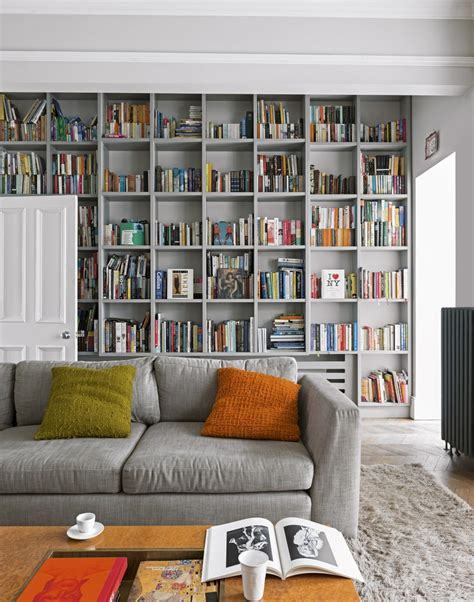 grey living room with floor to ceiling bookcases home