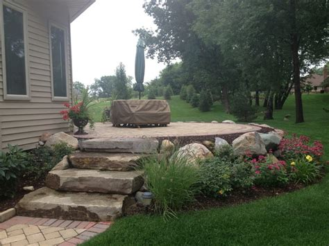 patio furniture boulder raised patio with boulder retaining wall