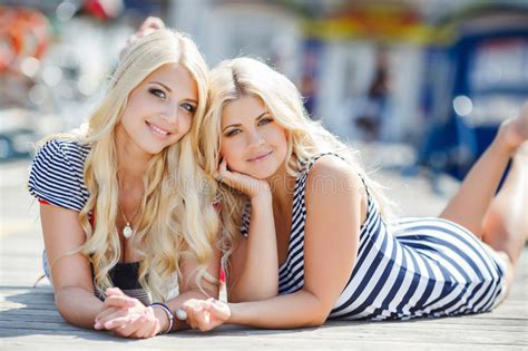 sexy woman blond hair stock photography image 10097442 two blonde near yacht club stock image image of allure