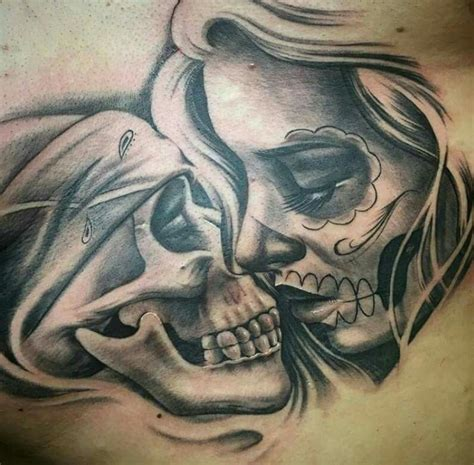 skull kissing tattoo of brown by honor