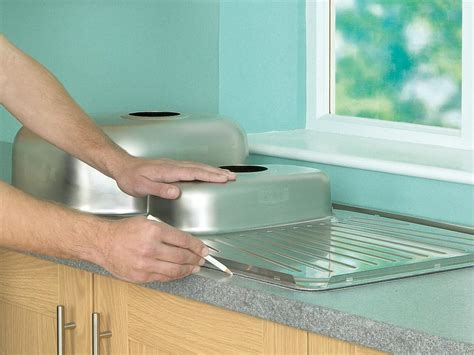 How To Cut Kitchen Countertop For Sink by How To Install A Kitchen Sink In A Laminate Or Wood