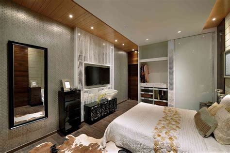 design bedroom with tv bedroom bedding and cowhide area rug with bedroom tv unit