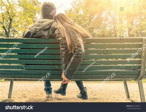 lovers on a park bench couple on bench two lovers sitting stock photo 223968511 shutterstock