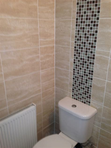 mosaic feature wall bathrooms bathroom ideas image t shaped shower bath supplied and fitted