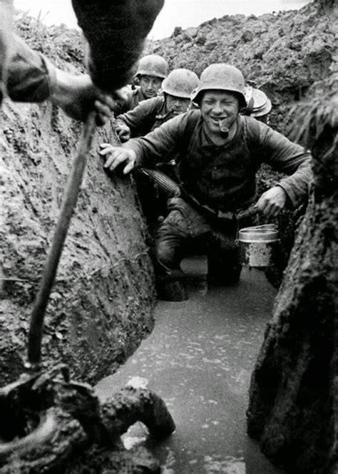 german soldiers in the flooded trenches 1943
