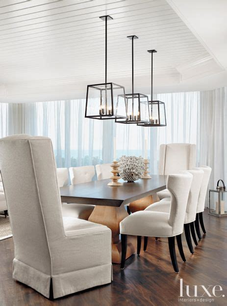 Lighting For Dining Room Table In This Stunning Dining Room Three Hunt Light Fixtures Are Suspended A Custom