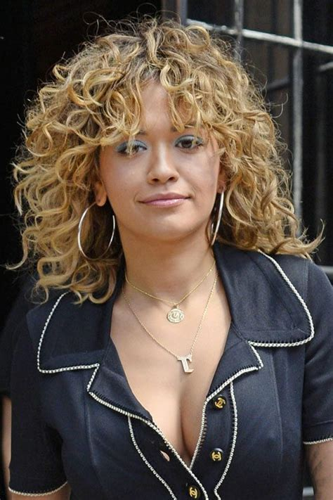 rita ora choppy hairstyles rita ora curly medium brown choppy layers hairstyle