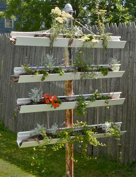 vertical garden made from gutters draws attention on