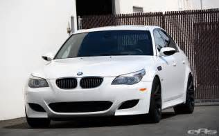 white bmw e60 m5 receives spacers and custom springs at
