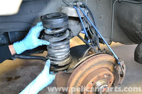 how to replace strut with spring in a place on a 2008 volkswagen eos mercedes benz 190e front strut and spring replacement w201 1987 1993 pelican parts diy