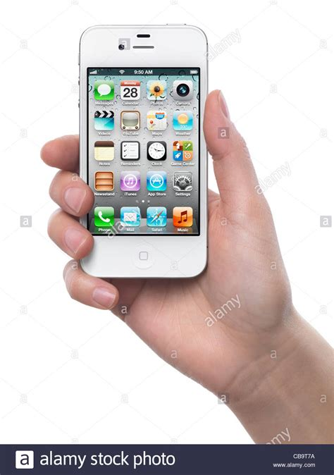varna bulgaria february 02 2015 female hand holding white woman hand with a white apple iphone 4s smartphone